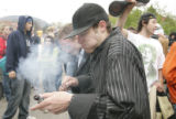 April 20, 2005- (BOULDER,CO) A student smokes off of a pipe a students at CU gathered in a parking...