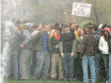 April 20, 2005- (BOULDER,CO) Students at CU move between sprinklers turned on them as they gather...