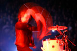 "(DENVER, CO Shot on 4/20/05) U2 lead singer Bono plays the drums during ""Love and..."