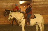(LOVELAND shot on 5/3/05) Sandy sits, aboard Charlie, watching as her student, Kelli Wemp, riding...