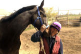 (LOVELAND shot on 5/3/05) Sandy gets a nuzzle from Cash Prospector. Sandy Schleiffers(cq) is a...