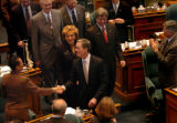 (DENVER, CO., JANUARY 13, 2005)  Colorado Gov. Bill Owens, center, shakes hands with House...