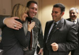 Gina London (cq), left, of Denver, hugs Baghdad City Council member Omar Mohammed Amin Al Rahmani...