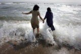 (1/18/05, Kaalapet, India)   Zenia Tata helps Anita get back into the water that took her niece...