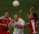 Evergreen player Laura Wilson (middle white #7) is tries to gain possession of the ball being...