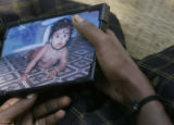 (1/18/05, Kaalapet, India)  Malini, the mother of 2-year-old Varsha, who died in the water surge,...
