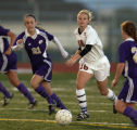Fort Collins High School's Randi Lucero-Wilson (21)  and Rocky Mountain High School's Alex...