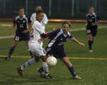Rocky Mountain High School's Estelle Johnson, foreground left, and Fort Collins High School's...