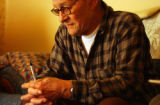 Glynn Fontenot (cq), 67, of Aurora sits in his living room talking about his step-granddaughter...