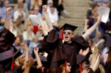 Eric Eugene Bontrager cheers as he is recognized as a graduate of the University of Colorado...