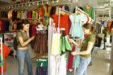 Shoppers  Kristal Sias (cq), left, Katey Felling (cq),right, look at cloths in American Apparel at...