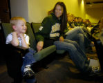 Brice Warden, left - three years old, sits with Brianna Willhite (cq) ( next to Warden) and the...