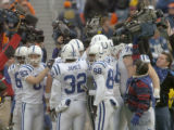 (DENVER, CO., JANUARY 02, 2005)  Indianapolis Colts' offense huddles during pregame prior to...