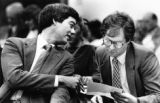State Rep. Bill Owens, R-Aurora, left, confers on a bill dergulating jeep tours with Greg Romberg,...