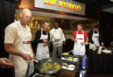 ESPN Zone Corporate Chef Will Holt, center, supervises Colorado Rockies rookies Clint Barmes,...