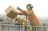 [(Fort Morgan , CO, Shot on: 1/4/05)]  Fort Morgan fire fighters clear Highway 52 of the personal...