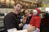 Jason Shidler(cq) his wife Amy and their 1 year old daughter Gabriela(cq) ham it up in the deli as...