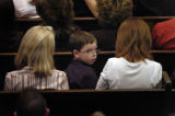 Tanner Segura, 7, attends the funeral services of his father, Denver Police Detective, Donald...