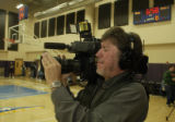 Ray LeJeune,(cq) photojournalist, works to video capture the final minutes of practice today....