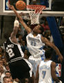 Denver Nuggets Marcus Camby, right, fouls San Antonio Spurs #2 Nazr Mohammed as he takes the ball...