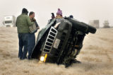 (STRASBURG, Colo.,  January 4, 2005)  (L-R) Todd Isaac (husband) and passerby Jeff Linnebur help...