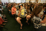 "Jake Marley, cq, 39, of Centennial, reads Jane Fonda's new book ""My Life so Far"" as he..."