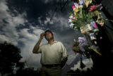 Luis Romero, 48, of Denver, stands next to a memorial for his son, Luis Romero, Jr., 21, that was...