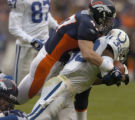 (DENVER, CO., JANUARY 02, 2005) Denver Broncos's #47, John Lynch and #75, Monasanto Pope wrap up...
