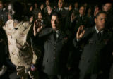 Twenty-five members of the U.S. Armed Forces and one spouse are sworn in as new U.S. citizens at...
