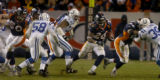 (DENVER, CO., JANUARY 02, 2005) Denver Broncos' #26, Tatum Bell races through a hole in the...
