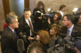 Denver D.A. Mitch Morrissey (cq Mitch Morrissey) ,left, addresses the media after suspected serial...