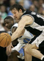 San Antonio Spurs Beno Udrih and Denver Nuggets Earl Boykins eye a loose ball during first quarter...