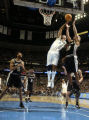 Denver Nuggets DerMarr Johnson battles for an offensive rebound against San Antonio Spurs Bruce...