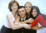 Robert Murray with his mother, left, and two sisters, right. (FOR THE NEWS) ***Jim Sheeler needs...