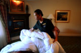 Broadmoor Hotel Housekeeper Judith Kenton (cq), 29, cleans up after a guest in one of the hotels...