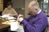 Tom Hanson, (RIGHT) purple sweater, bald, teacher, works on the vote count with Diane Waco,(LEFT)...