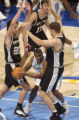 Denver Nugget guard, Greg Buckner (middle), is surrounded by San Antonio defenders, Manu Ginobili...