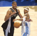 San Antonio's, Tim Duncan (left) is fouled by  Denver Nugget foward, Kenyon Martin, (RIGHT)  in...