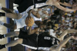 Denver Nuggets Greg Buckner looks for a way out as he is boxed in by  San Antonio Spurs Manu...