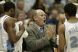 Denver Nuggets head coach George Karl talks with his team during a break in third quarter action...