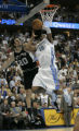 Denver Nuggets Carmelo Anthony struggles under the basket against San Antonio Spurs Manu Ginobili...