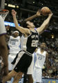 San Antonio Spurs Manu Ginobili stretches for an offensive rebound against an unknown Denver...