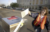 Brenda Beins ( cq Brenda Beins) gathered ballots from passing motorists in front of the Denver...