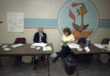 L to R: Election officials Marie Baum (cq Marie Baum) and Mary Jo Snell (cq Mary Jo Snell) wait...