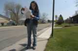 Maria Romero (cq), a volunteer for Denver Voters for Responsible Spending, looks at a list of...