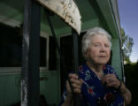 Anna Thomas (cq) stands on the porch of her home at 12th Ave. and  Kenton St. on Wednesday...