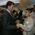 Broncos safety John Lynch, left, shakes hands with Lac Nguyen after Lynch's  7th annual Salute the...