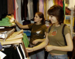 Shoppers Katey Felling (cq), left, and Kristal Sias (cq), right, look at cloths in American...