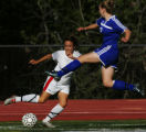 Heritage Athletics forward Taylor Nicholls, left, pulls the ball away from the leaping defense of...