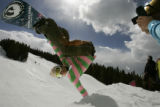 K2 Snowboards rider Leanne Pelosi, cq, 22, performs a front side hand plant as photographer Mark...